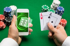 Casino player with cards, smartphone and chips Stock Photos
