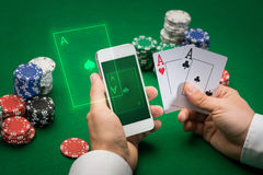 Casino player with cards, smartphone and chips Royalty Free Stock Photos
