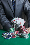 Casino player show his cards. Royal Flush On The Green CasinoBackground Stock Image