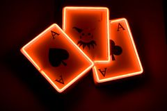 Casino playing cards concept. Casino sign - label. Three playing cards - aces and joker Royalty Free Stock Images