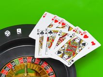 Casino - playing cards on green broadcloth. Stock Photos