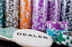 Casino poker chips. Colored casino gambling poker chips, cards and dealer button Stock Photos