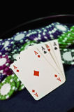 Casino poker chips and aces Royalty Free Stock Photo