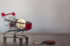 Casino poker chips and a bitcoin on shopping cart. Gambling concept. Casino poker chips on shopping cart with copy space. Gambling concept royalty free stock image