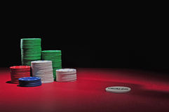 Casino poker chips and dealer stock image