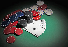Casino poker chips with royal flush. Several stacks of casino chips of various heights and colors with a royal flush, all sitting on a green colored playing Royalty Free Stock Image