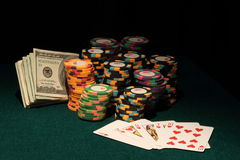 Casino Poker chips with Royal flush and Money Stock Photo