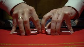 Casino, poker: Dealer shuffles the poker cards stock video footage