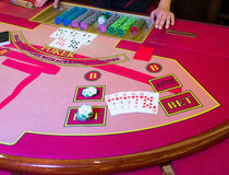 Casino Poker game. Straight Flush of hearts winning combination on the table Royalty Free Stock Photography
