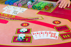 Casino Poker game. Straight Flush of hearts winning combination on the table Royalty Free Stock Photo