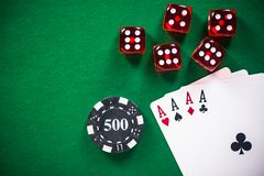 Casino poker games related items on green table.  stock photo