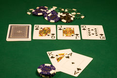 Casino poker on green table. Win on high stakes poker in casino royalty free stock photo