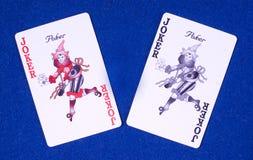 Casino poker joker cards. Two different coloured poker joker cards Royalty Free Stock Photos