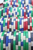 Casino poker money chips texture. Stack of poker chips as background. Token, casino money tokens as pattern. Stock Photo