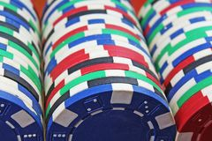 Casino poker money chips texture. Stack of poker chips as background. Poker casino token tokens as background. Stock Image