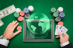 Casino poker player with cards, tablet and chips Royalty Free Stock Photos