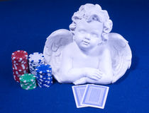 Casino poker pokerface. Lucky charm poker angel with pokerface cards and chips Stock Image