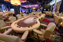 Casino and poker table. Poker table and chairs in casino Royalty Free Stock Image