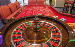 Casino. Red Roulette table in casino close up stock photo