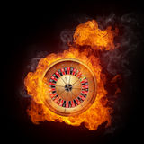 Casino Roulette. In Fire  on Black Background Royalty Free Stock Image