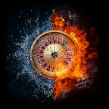 Casino Roulette. In Water and Fire  on Black Background Royalty Free Stock Image