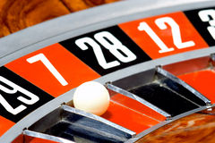 Casino, roulette. Roulette wheel with playball on 7 stock photo