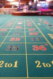 Casino roulette betting table green felt carpet. Closeup of roulette table with green betting carpet in cruise ship casino lounge Stock Photos