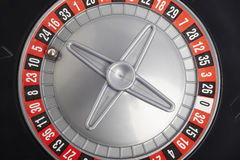 Casino roulette detail with ball in number five. Gambling Stock Photo