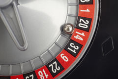 Casino roulette detail with ball in number fourteen. Gambling Royalty Free Stock Photos