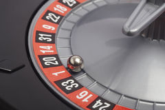 Casino roulette detail with ball in number one. Gambling Stock Photos