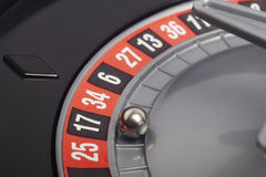 Casino roulette detail with ball in number seventeen. Gambling Royalty Free Stock Photography