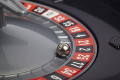 Casino roulette detail with ball in number twenty-five. Gambling Royalty Free Stock Images