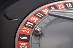 Casino roulette detail with ball in number twenty seven. Gambling Royalty Free Stock Photo