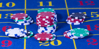 Casino roulette game. Casino american roulette table with chips Stock Images