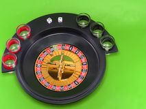 Casino roulette on green broadcloth. Royalty Free Stock Photos