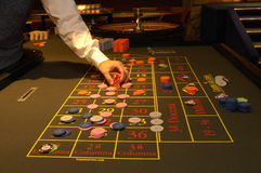 Casino. Roulette, hand betting chips Stock Image