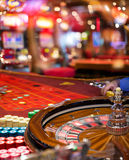 Casino - Roulette In Motion With Blurred Slot. In Background stock photo