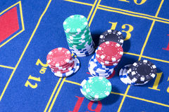 Casino roulette table with  game. Casino american roulette table with various chips Royalty Free Stock Photos