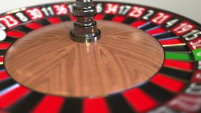 Casino roulette wheel ball hits 5 five red. 3D animation stock footage