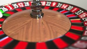 Casino roulette wheel ball hits 32 thirty-two red. 3D animation stock footage