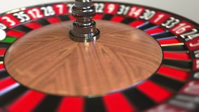 Casino roulette wheel ball hits zero, 3D animation stock video footage