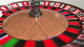 Casino roulette wheel ball hits 18 eighteen red. 3D animation stock footage