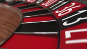 Casino roulette wheel ball hits 5 five red stock footage