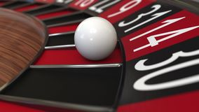 Casino roulette wheel ball hits 14 fourteen red. 3D rendering. Casino roulette wheel hits 14 fourteen red, close-up shot Stock Photos