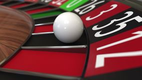 Casino roulette wheel ball hits 35 thirty-five black. 3D rendering. Casino roulette wheel hits 35 thirty-five black, close-up shot Royalty Free Stock Photos