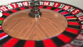 Casino roulette wheel ball hits 3 three red. 3D animation stock video footage