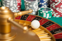 Casino roulette wheel with the ball on number 5 Royalty Free Stock Images