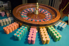 Casino roulette wheel and gambling chips Stock Images