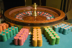 Casino roulette wheel and gambling chips Stock Image