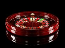 Casino roulette wheel isolated on black background. 3d rendering realistic illustration. Online casino roulette gambling royalty free stock photos